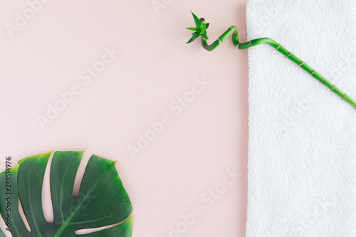 Poster de jardin Spa Flat lay of spa concept with white towel, bamboo and palm leaf, spa background with a space for a text, flatlay, view from above.