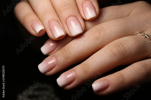 Amazing natural nails. Women's hands with clean manicure. Canvas Print