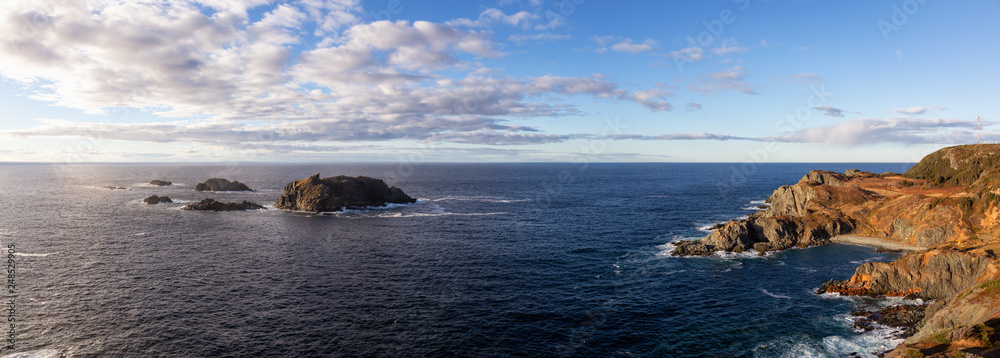 Fototapety, obrazy: Striking panoramic seascape view on a rocky Atlantic Ocean Coast during a vibrant sunset. Taken at Crow Head, North Twillingate Island, Newfoundland and Labrador, Canada.