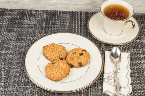 Fotografia, Obraz  Tea with Oatmeal and Raisin Cookies on Elegant China