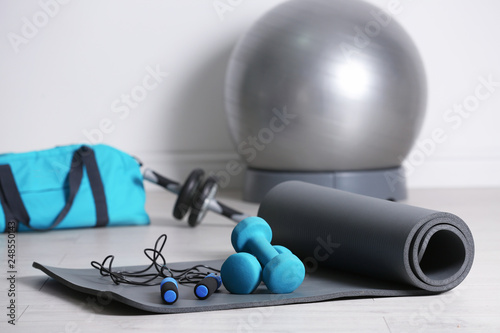 Fototapeta Set of fitness equipment on floor indoors obraz