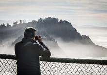 Man Looking Through A Camera A...