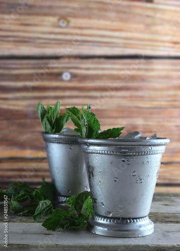 Valokuva Image for Kentucky Derby in May showing two silver mint julep cups with crushed