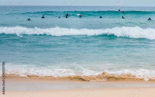 Photo Surfers on waves at Bondy beach Australia