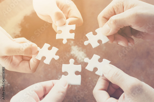 Photo  Hand of diverse people connecting jigsaw puzzle