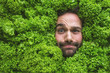canvas print picture - Mann mit Salt , Konzept für Lebensmittelindustrie. Gesicht von lachenden mann  in Salat Fläche.