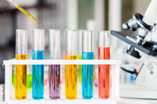 Photo  scientist with equipment and science experiments, laboratory glassware containin