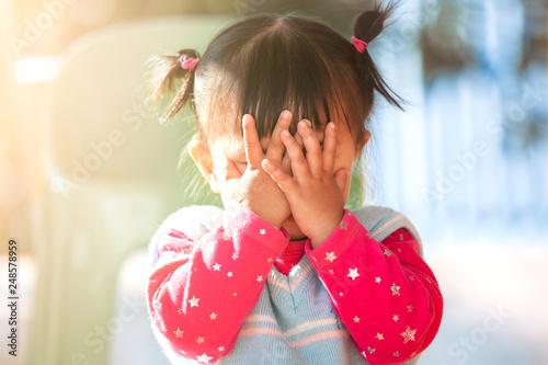 Cute asian baby girl closing her face and playing peekaboo or hide and seek with Tapéta, Fotótapéta