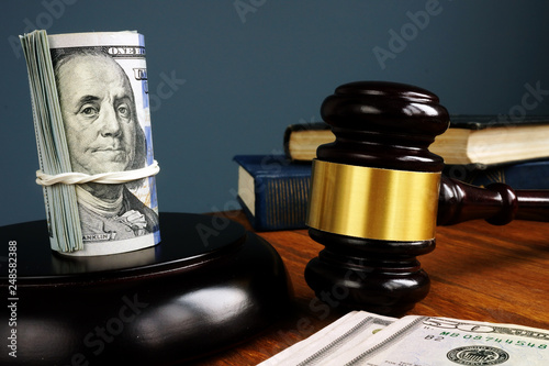 Bail bonds and fine concept. Money and gavel as symbol of law. Canvas Print