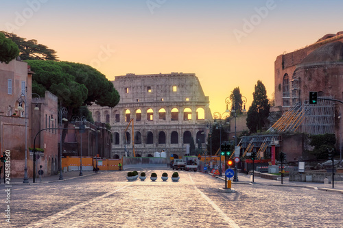 Fotobehang Wenen Roman street at dawn with a view of the Colosseum, Rome, Italy.