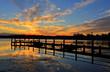 Beautiful sunset and timber jetty silhouette