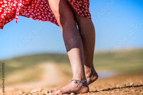 The gypsy woman without shoes on the ground. Wallpaper Mural