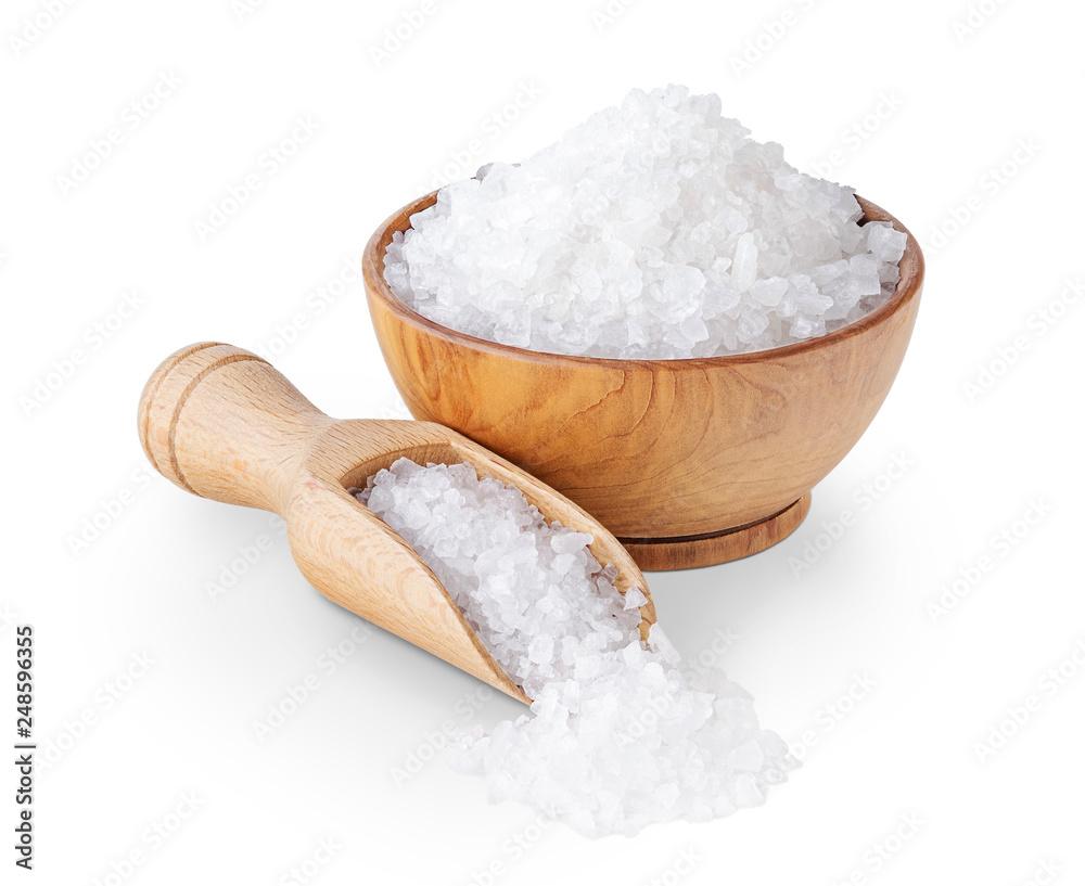 Leinwandbild Motiv - andriigorulko : Sea salt crystals in a wooden bowl isolated on white