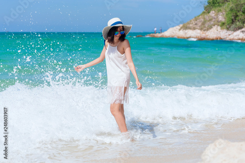 8a6418d94c Summer time woman vacation on the beach. Cheerful woman wear summer dress  and straw hats sitting ...