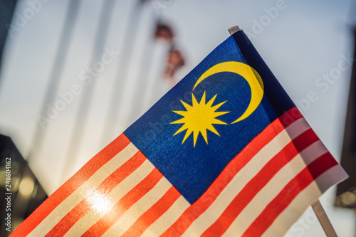 Fotografía  Malaysia flag also known as Jalur Gemilang wave with the blue sky