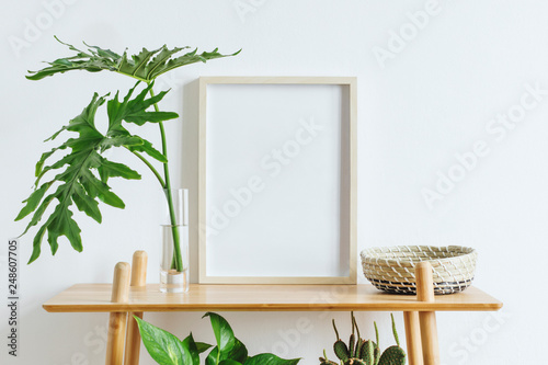 Fotomural Scandinavian room interior with mock up photo frame on the brown bamboo shelf with beautiful plants, tropical leafs and accessories