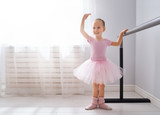 girl is studying ballet.