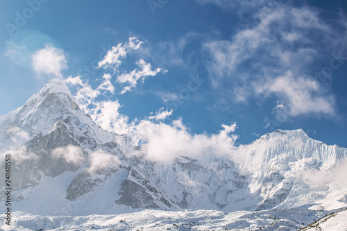 Foto auf Gartenposter Gebirge Beautiful mountain peak in the clouds