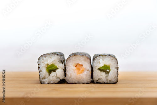 Foto  Japanese food Sushi Roll Maki of Salmon and avocado