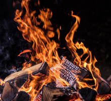 Flaming Logs, Fire Flames With Sparks Flying In The Air, Close-up.