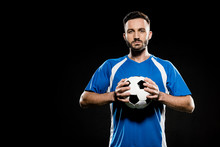 Football Player Holding Ball In Hands Isolated On Black