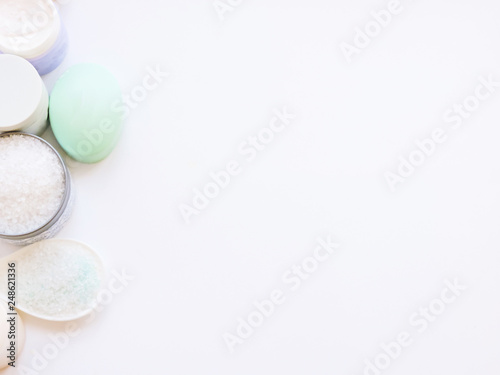 Fotobehang Macarons Spa treatments. Beautiful spa composition with flowers on table close up. Spa still life with aromatic candles,candle background light table relaxation spa beauty aromatherapy luxury closeup.