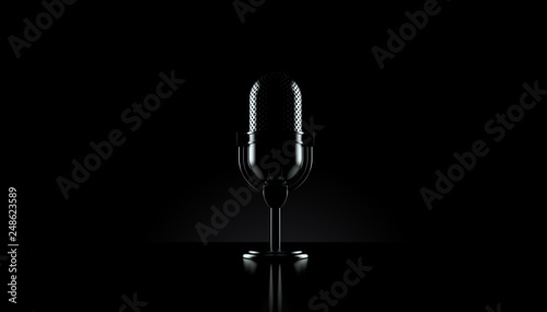 Foto Radio microphone on black background