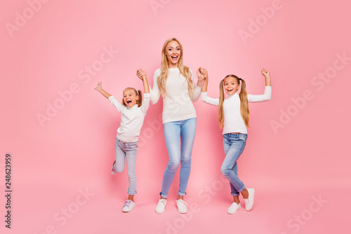Full length size body portrait of nice cute attractive charming lovely lovable cheerful cheery kind people mom mum holding hands spending free spare time isolated over pink pastel background - 248623959