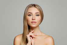 Perfect Young Woman. Pretty Girl With Healthy Blonde Hair And Clear Skin Portrait. Facial Treatment, Cosmetology, Hair And Skin Care Concept