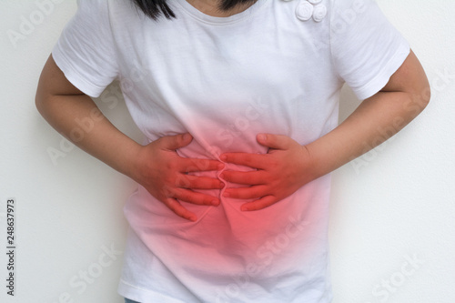 Woman Child's hands on her stomach with red spot as suffering on stomachache Canvas-taulu