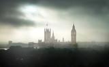 Fototapeta Londyn - Big Ben and Houses of Parliament at dark misty day. London, UK