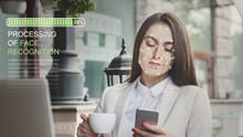 Woman Using Biometric Facial Verification On Smartphone