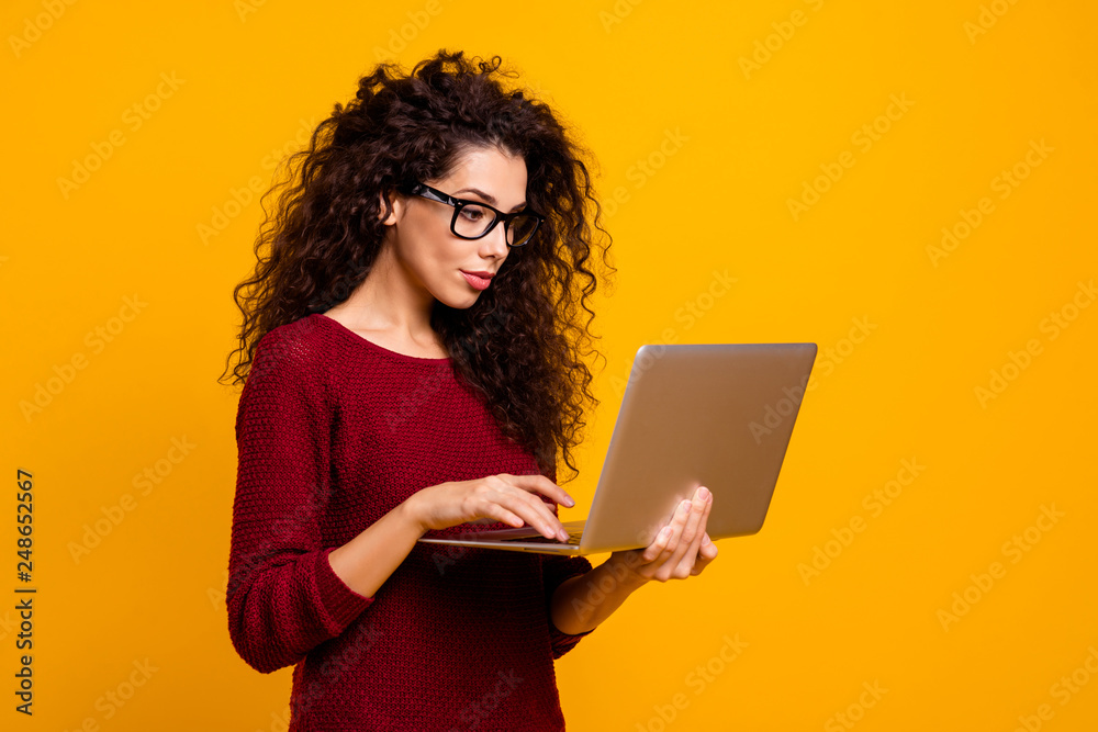 Fototapeta Profile side view portrait of her she nice clever smart intelligent genius cute attractive pretty cheerful wavy-haired lady holding in hands laptop isolated over bright vivid shine orange background