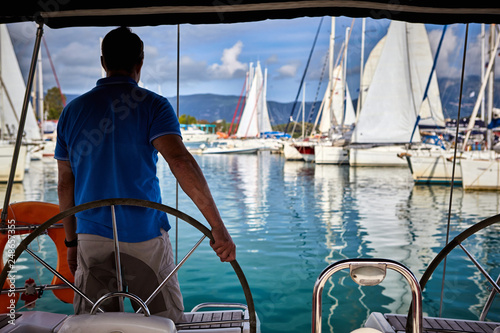 A man drives a yacht