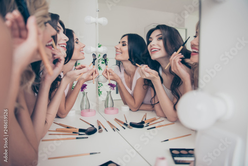 Obraz Portrait of nice cute winsome attractive lovely well-groomed glamorous shine cheerful girlfriends having fun blush blusher in light white interior decorated house indoors - fototapety do salonu