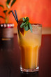 Orange coctail with ice, lemon and mint
