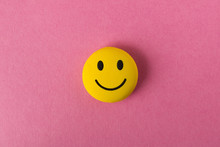 Funny Smiley Face On Pink Back...