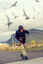Expert Photographer Taking Shots In A Dangerous Situation