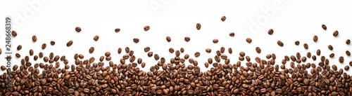 Fotografering Panoramic coffee beans border isolated on white background with copy space
