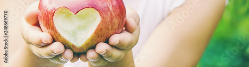 Fototapeta Child with Child with an apple. Selective focus. obraz