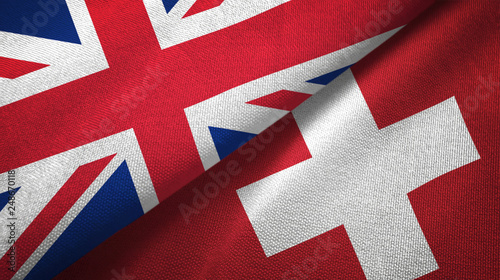 Fotografie, Obraz  United Kingdom and Switzerland two flags textile cloth, fabric texture