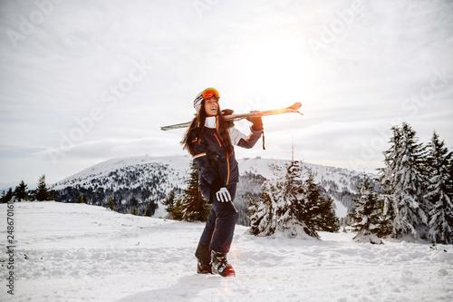 Fototapeta enjoying skiing at ski resort in mountains on a sunny winter day