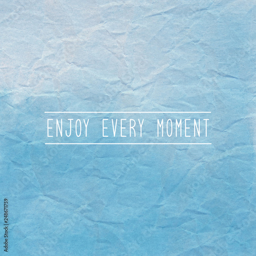 Poster Positive Typography Enjoy every moment on blue crumpled paper