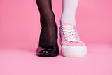 Cropped close-up view image concept photo of two different fit thin slim legs cozy comfort luxury luxurious elegant chic sporty comparison footgear isolated on pink pastel background