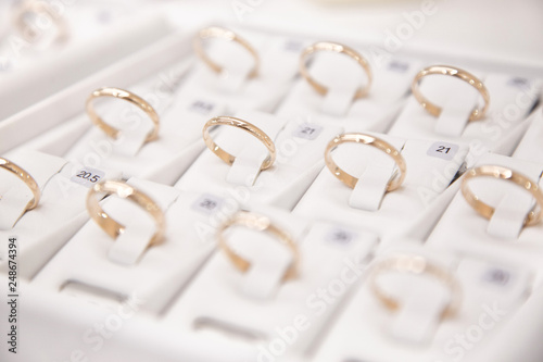 Fotografie, Tablou  Jewelry, golden rings in jewelry shop, close-up