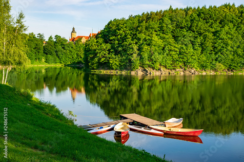 Fotografia  Boats moored on Lesna lake near Czocha Castle at sunny summer morning , Lower Si
