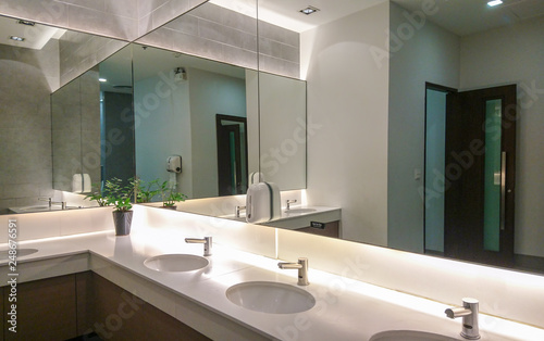 Faucets with washbasin and big mirror