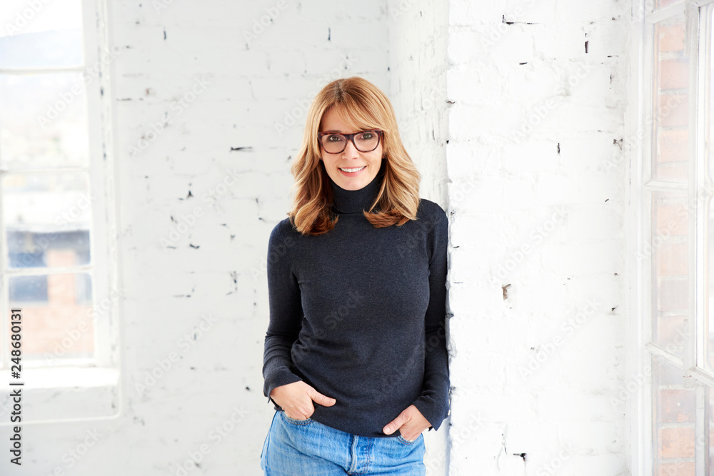 Fototapety, obrazy: Portrait of attractive woman wearing roll neck sweater and jeans while looking at camera and smiling