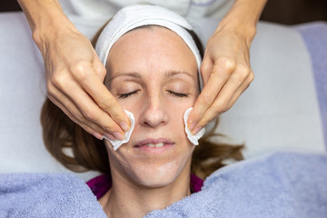 Fototapeta na wymiar Woman enjoying a facial cleansing treatment