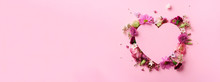 Creative Layout With Pink Flowers, Paper Heart Over Punchy Pastel Background. Top View, Flat Lay. Spring, Summer Or Garden Concept. Present For Woman Day. Banner